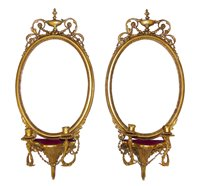 364 - A pair of Regency Gesso framed oval Girandole wall mirrors.