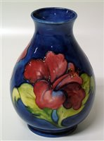 Lot 142-Moorcroft hibiscus vase 19cm tall