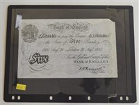 Lot 22-An album of banknotes to include a Bank of England white Five Pounds note.