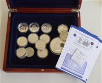 Lot 14-Assortment of various maritime themed modern commemorative coins and three coin covers.