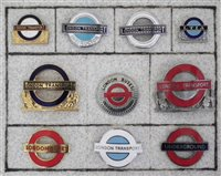 Lot 7-Nine London Transport bus and underground enamel cap badges