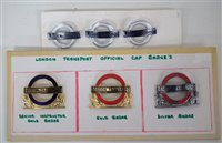 Lot 26-Six London Transport bus and underground enamel cap badges