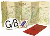 Lot 57-Marcos enamel car badge, GB AA aluminium badge and a Daily Mail Road map.