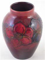 Lot 74 - Moorcroft flambe vase, decorated with clematis pattern