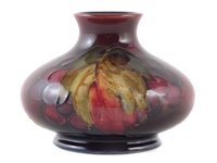 Lot 73 - Moorcroft flambe vase, decorated with leaves and berries pattern