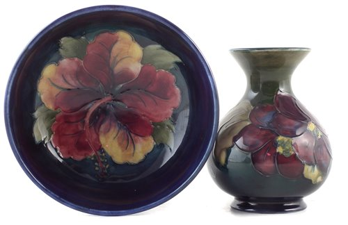 Lot 78 - Moorcroft vase and a bowl, decorated with Hibiscus and Clematis patterns