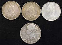 Lot 25-Three Queen Victoria Shillings and a Victoria Diamond Jubilee silver medal (4).