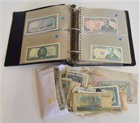 Lot 20-World banknote collection contained within one album with a selection of loose notes.