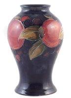Lot 80 - Moorcroft pomegranate vase.