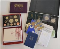 Lot 50-Two albums together with a 1997 proof set and numerous other commemorative crowns etc.