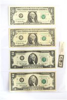 Lot 23-Three assorted albums of foreign banknotes.