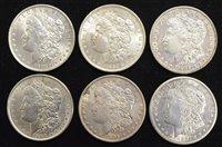Lot 2-Six assorted USA silver Morgan Dollars (6).