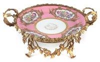 Lot 51-Serves porcelain tazer dated 1843 in ormolu mount
