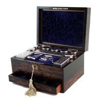 Lot 4-Mid 19th century coromandel veneered vanity box.