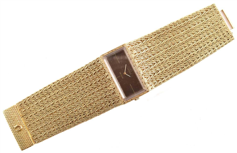 88 - Ladie's vintage Omega De Ville 18ct gold cuff bracelet watch