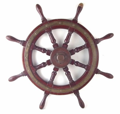 "Lot 187-Mahogany ships wheel, brass boss with eight spokes, diameter, 76cm (30"")."