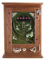Lot 24-Penny Slot machine possibly by T.W. Flory