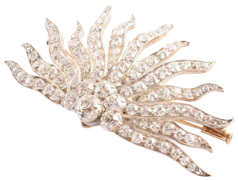 Lot 87-7ct diamond Edwardian sun-ray brooch