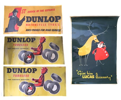 "Lot 130-Three Dunlop Tyre promotion posters and a Christmas poster ""Give Him a Lucas Accessory"", 76cm (30"") x 51cm (20"")."