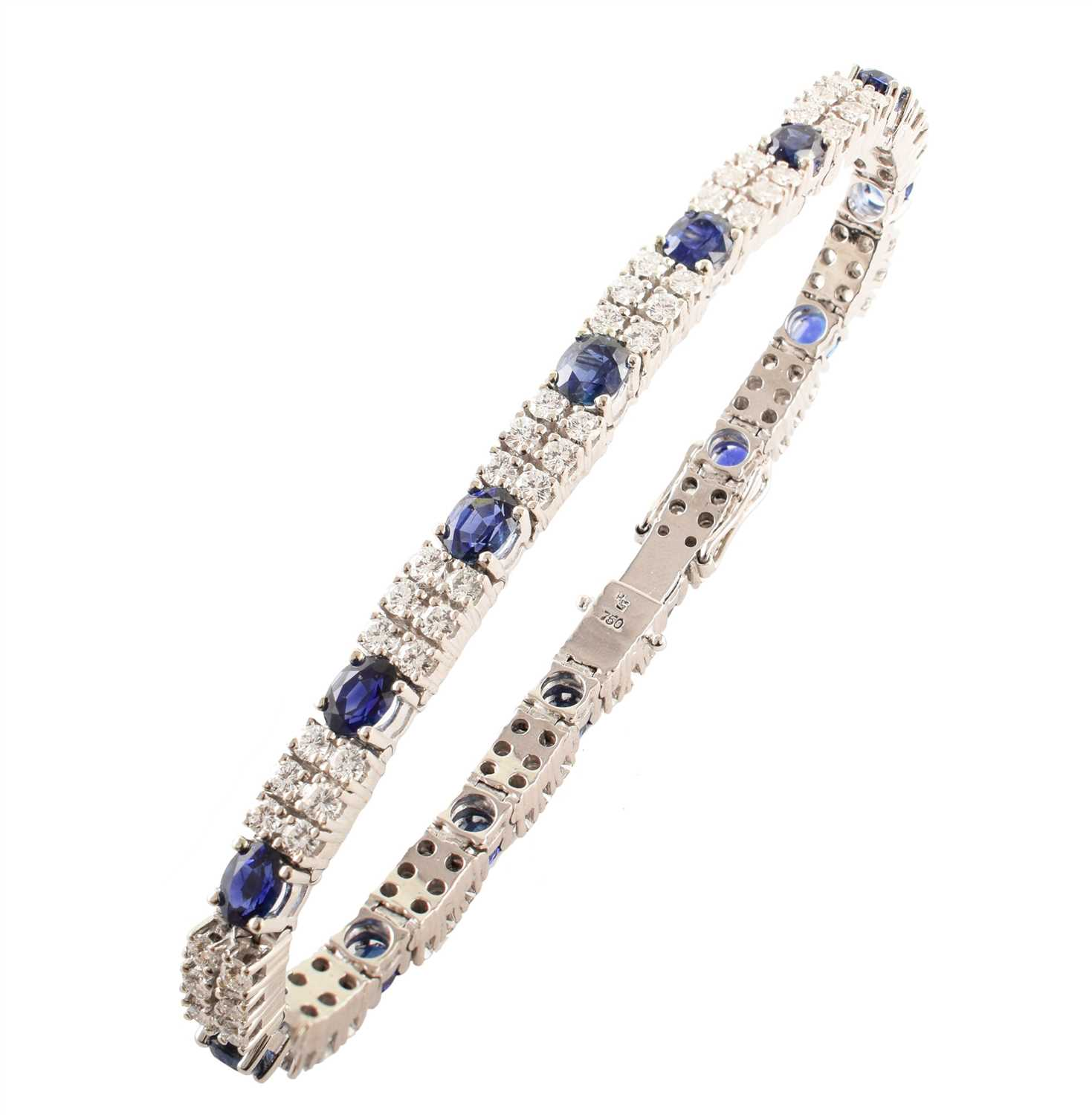 Lot 28-Sapphire and diamond two-row 18ct white gold line bracelet