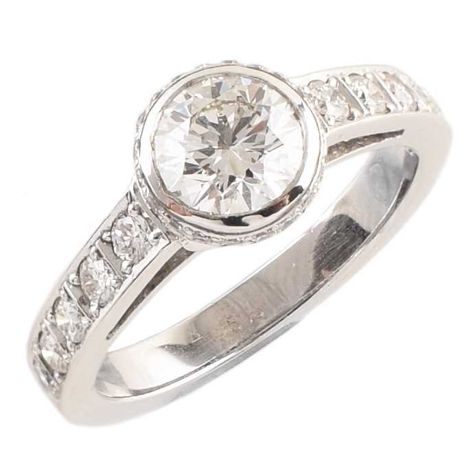 Lot 71-Diamond solitaire 14ct white gold ring