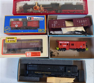 Lot 183-Boxed Rivarossi locomotive GR-691-022, Missouri Old Time box car, H O Woodsheathed box car, Athearn Train Trainmaster bay window caboose and Wisconsin central railbox