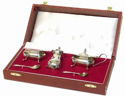 Lot 23-A cased silver cruet set