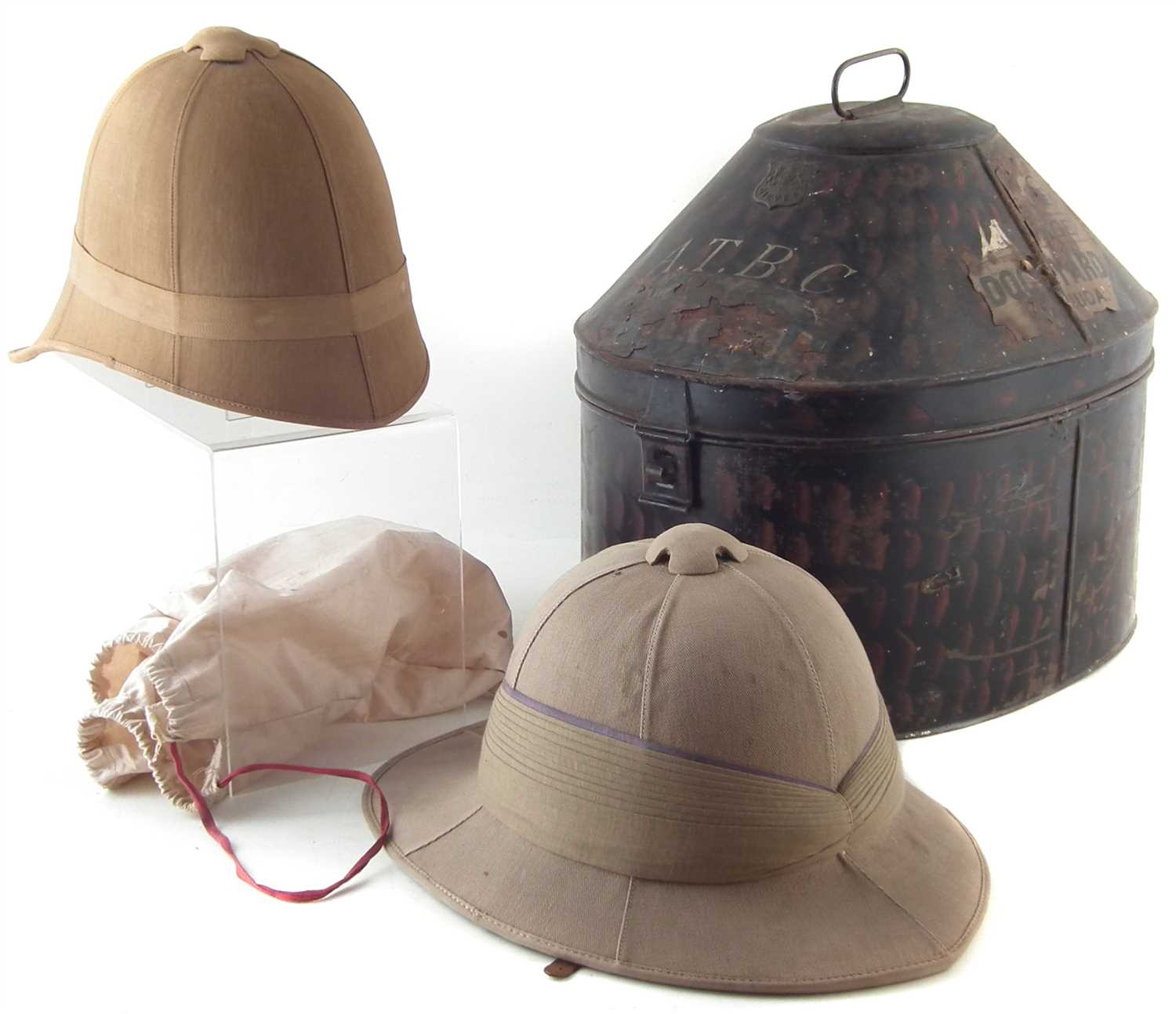 219 - Two Pith helmets, one with tin case, Boer war era,