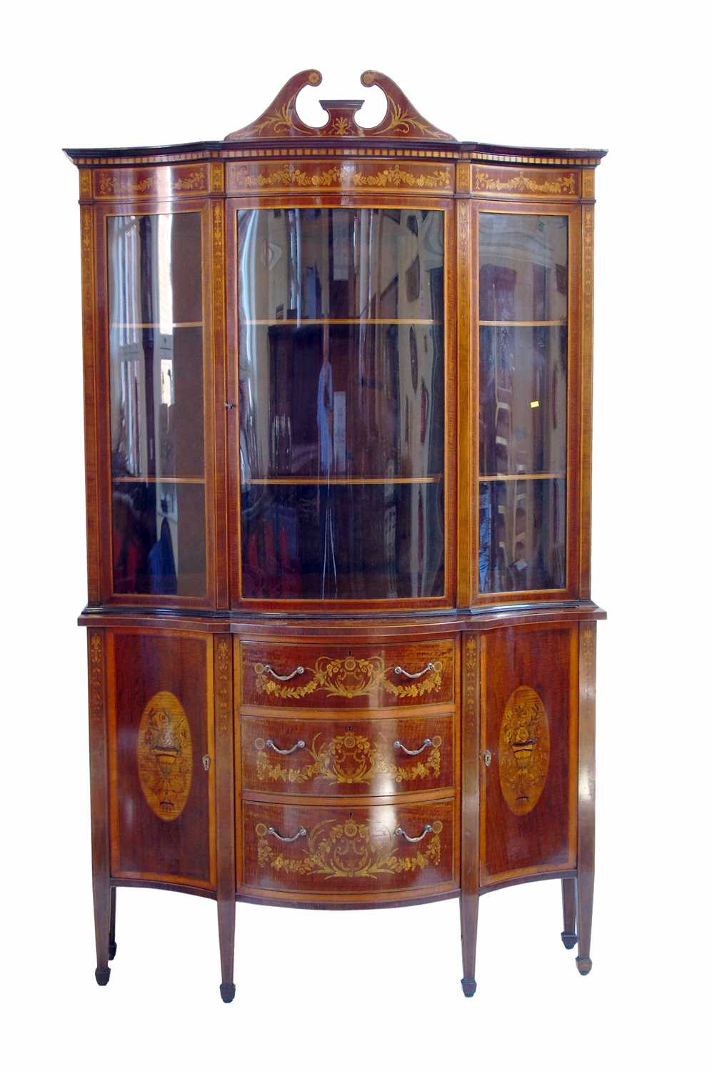 491 - Late 19th century serpentine front, glazed display cabinet by Edwards & Roberts.
