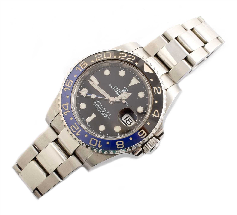 142 - A Gent's Rolex Oyster Perpetual date GMT-Master-II steel bracelet watch.