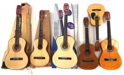 Lot 51-Six nylon strung guitars