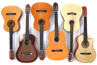 Lot 52-Six nylon strung guitars