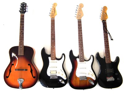 Lot 57-Three electric guitars and a steel strung acoustic