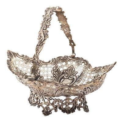 Lot 46-Silver swing-handled basket by Goldsmiths & Silversmiths