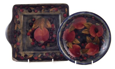 Lot 239 - Moorcroft dish and two handled bread and butter plate, pomegranate pattern.