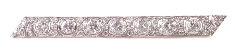 Lot 81-A diamond set platinum bar brooch.
