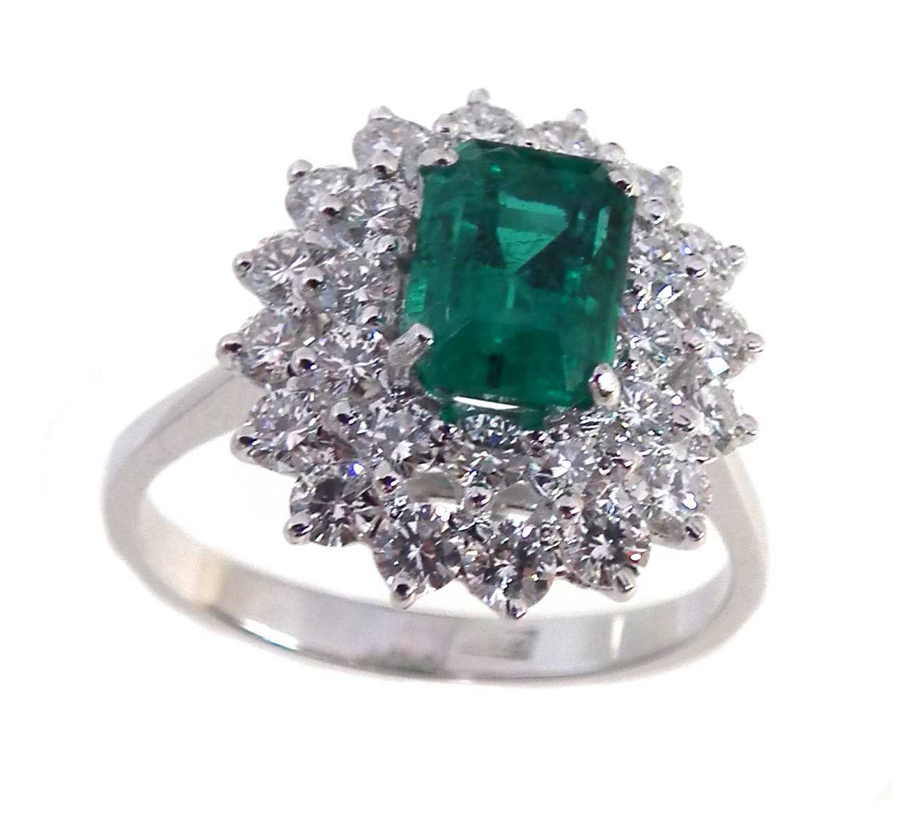 Lot 116-Emerald and diamond 3-tier oval cluster platinum ring.