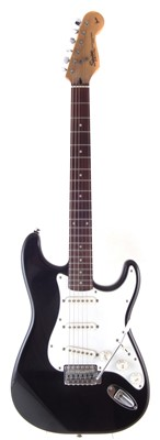 Lot 60-Squier by Fender stratocaster with accessories.