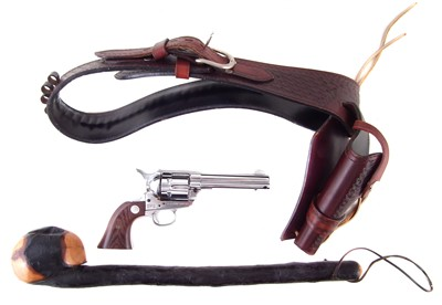 Lot 42-Replica Colt SAA 1873 by Kokusai Sangyo with belt and holster also a carved wood club.