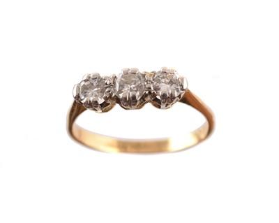 Lot 186 - An 18ct gold diamond three stone ring