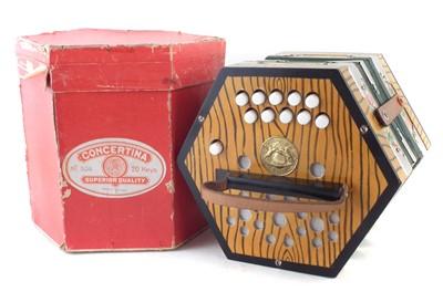 Lot 29-Geman twenty key concertina with card case
