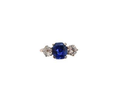 Lot 235-An 18ct gold Sri Lankan sapphire and diamond three stone ring