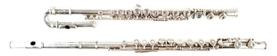 Lot 23-Artley Flute, Buffet curved head flute and a collection of music