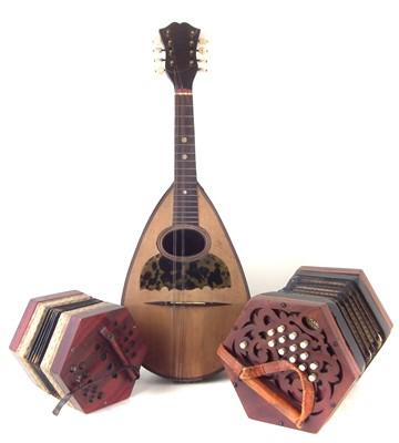Lot 31-Roylance twenty six key concertina, also a German 20 key concertina and a Pietro Tonelli mandolin