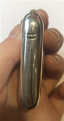 Lot 19-A Liberty & Co. Cymric silver and enamel vesta case designed by Archibald Knox
