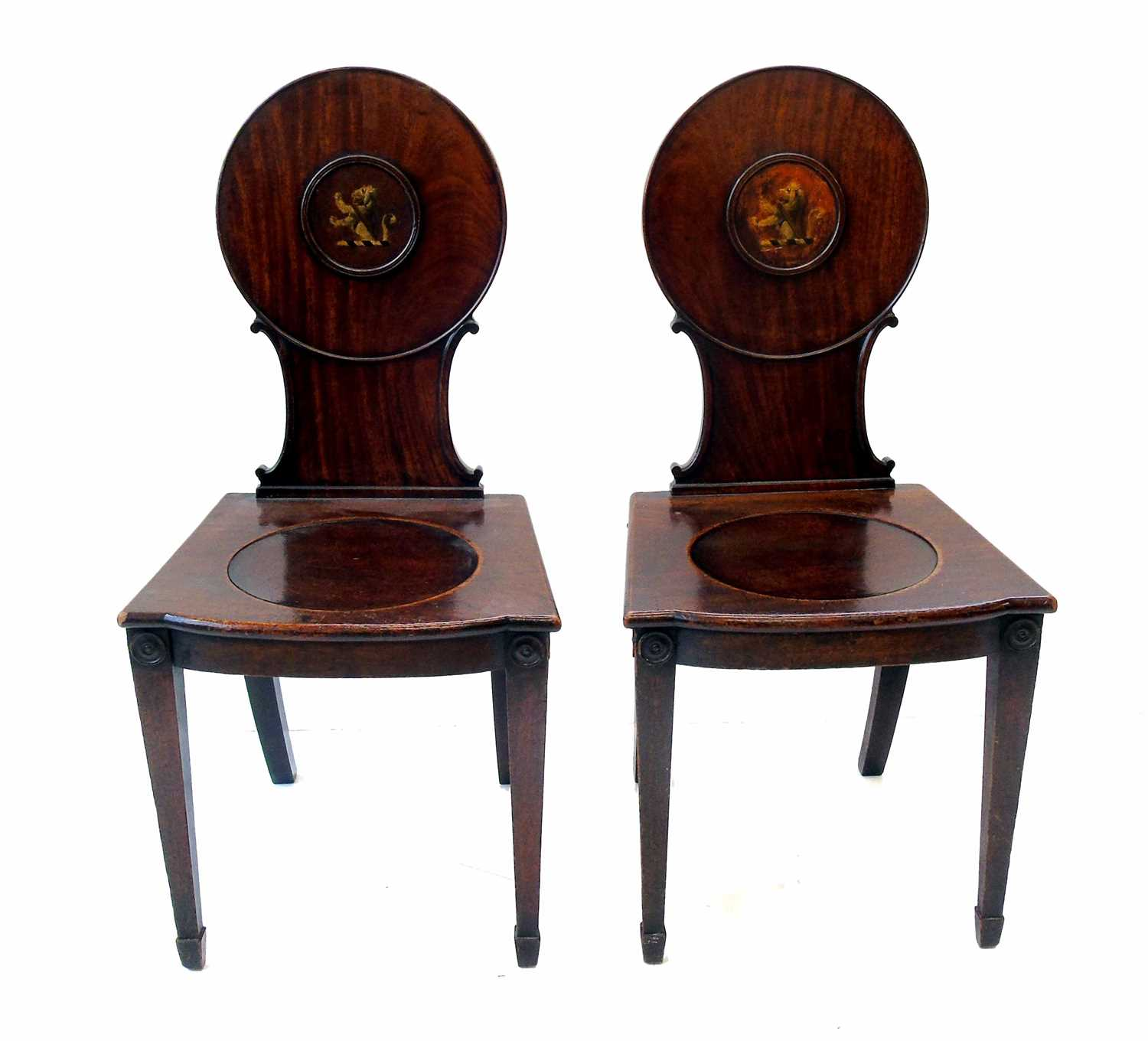 609 - A pair of George III mahogany hall chairs