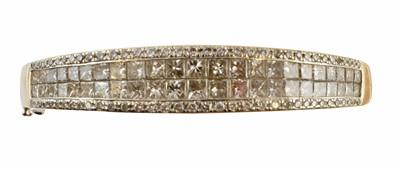 Lot 53-An 18ct gold diamond hinged bangle