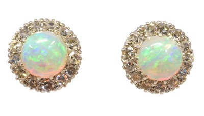 Lot 107 - A pair of opal and diamond earrings