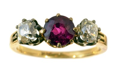 Lot 122-A ruby and diamond three stone ring.