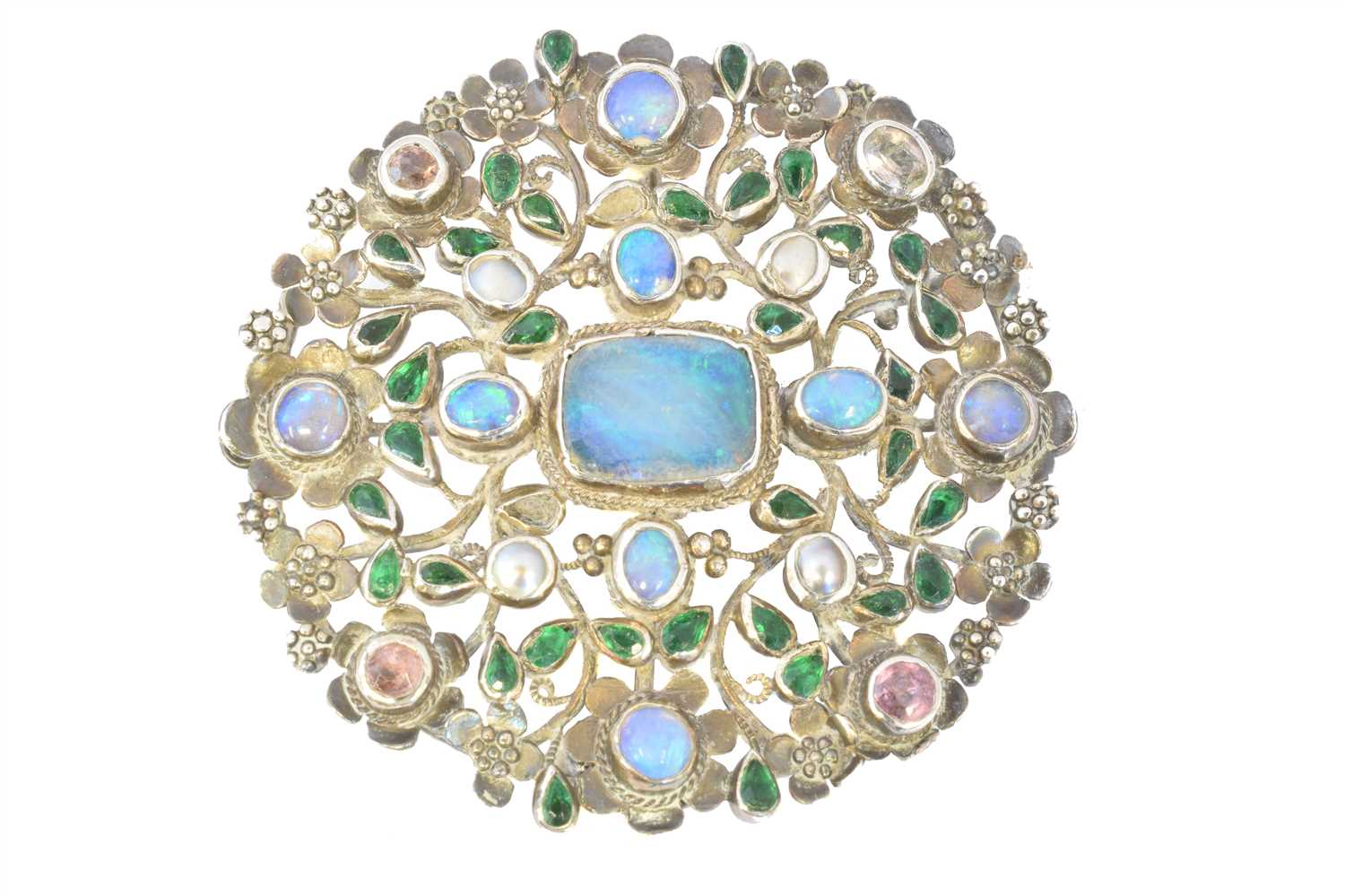 Lot 83-An Arts & Crafts opal and vari gem brooch attributed to Arthur and Georgie Gaskin